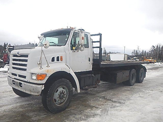 1998 Ford roll-off truck with 26' flatdeck body. 300 Cat with 10 speed. 18 & 40 axles. Full lock diffs on Hend springs. Solid cab. Good powertrain & drivetrain. Please contact for details unit# 19-080