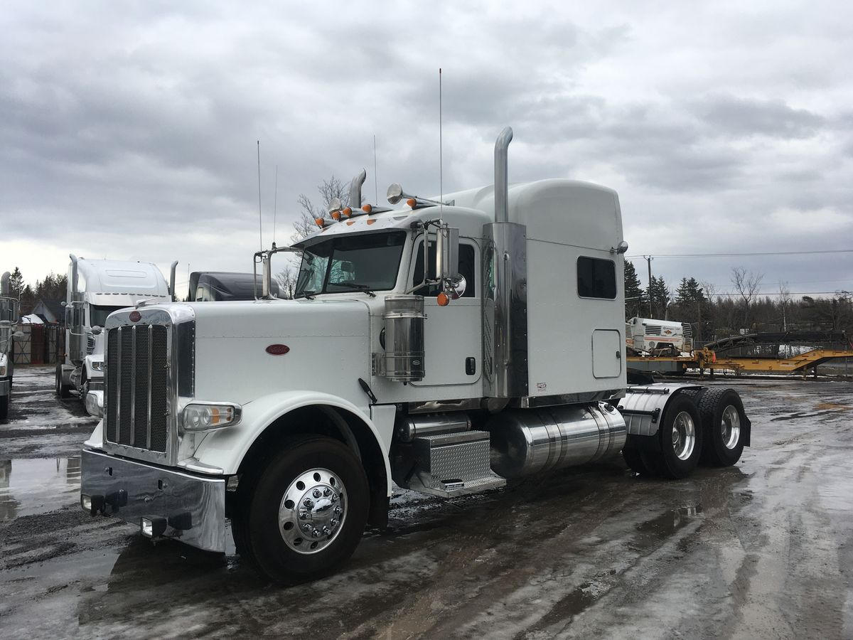 2013 Peterbilt 388 - #Stock: F1006 - Mileage: 1,034,434 Km - Color: White - Engine: Cummins ISX 500 HP - Engine Brake: Jacob - Exhaust: Double - Air Filter: Dual Stainless - Transmission: 18 Speed - Front Axles: 14,600 Lbs - Rear Axles: 46,000 Lbs - Traction: Full Lock - Ratio: 4.10 - Suspension: Air-trac - Wheels: Aluminum - Tires: 11R22.5 - Bunk: 63