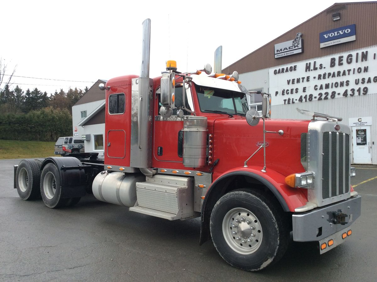 --- NEW TRUCK, IDEAL FOR FOREST TRANSPORT OR TRANSPORTATION OF HEAVY MACHINERY ---  PETERBILT 389 2017 - Stock number: F1025 - Mileage: 595,367 km - Exterior color: Red - Doors: 2 - Engine: Cummins - Power: 600 HP - Torque: 2,050 lbs - Brakes: in the air - Jacob engine brake: yes - Traction: Total lock - Exhaust: Double - Filterer: Donalson - Transmission: 18 Speeds 20918B - Front axle: 16,000 lbs - Rear axles: 46,000 lbs - Differential: Meritor - Ratio: 4.10 - Suspension: Neway ADZ246 - Cabin: with berth - Front wheels: 22.5 x 12.5 inches / Aluminum - Rear wheels: 24.5 x 8.25 inches / Aluminum - Front tires: 385 / 65R22.5 - Rear tires: 11R24.5 - Berth: 44 inches (low roof) - Wheelbase: 244 inches - Price on request only  Note that we have two locations where vehicles can be located, in Lévis or Saint-Georges. Please contact our advisors to inform you of the vehicle before you travel.