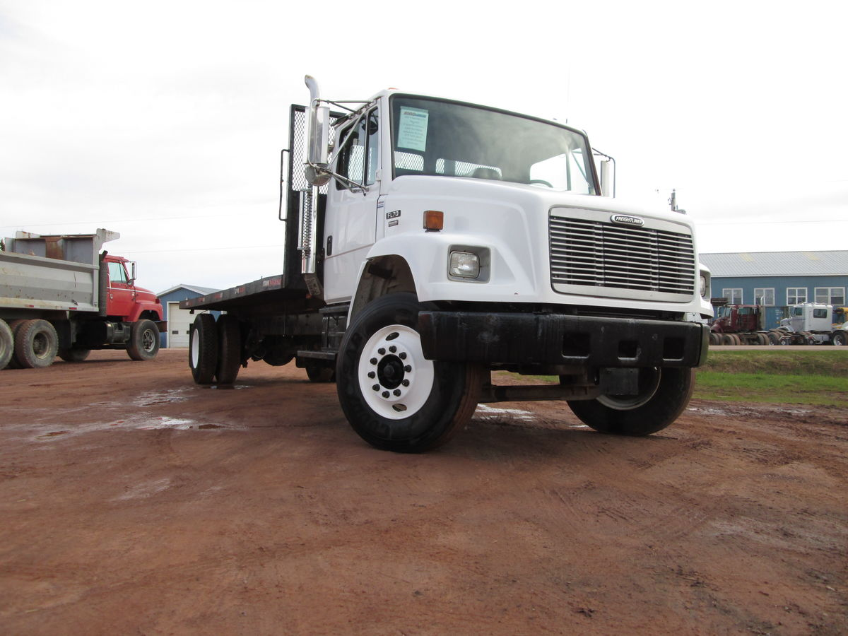 2002 Freightliner FL70 cab & chassis, Mercedes engine, 6 speed transmission, air brakes.  Axle ratings 12000lbs front, 23000lbs rear, wheel base 270', RS-23-160 differential 4.30 ratio, bud steel wheels, 11R22.5 tires 75% wear remaining.  Good working truck with 21 foot flat deck,  22'8