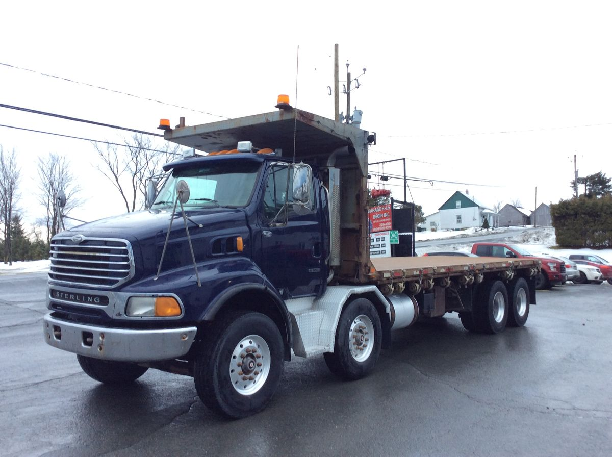 --- 12-WHEEL TRUCK, SMALL BUDGET, IDEAL FOR DUMP TRUCK ---  2006 STERLING LT9500 - #Stock: M2290 - Mileage: 1,096,471 km - Blue color - Brakes: in the air - Front axle: 18,00 lbs - Rear axle: 46,000 lbs - Wheels: aluminum - Front tires: 315 / 80R22.5 - Rear tires: 11R22.5 - Ratio: 3.56 - Wheelbase: 293 inches - Engine: Caterpillar C13 - Power: 430 hp - Exhaust: Simple - Filterer: Donaldson - Transmission: RTLO16918B - Suspension: Air Liner 46,000 Lbs - Cabin: Day-Cab - Equipment: Tandem not liftable, air suspension - Equipment: Hydraulic platform of 24 feet - Price on request only.  Please note that we have two places where vehicles can be, either in Lévis or Saint-Georges. We suggest that you contact one of our experienced advisors to be informed of the geolocation of the vehicle before traveling.
