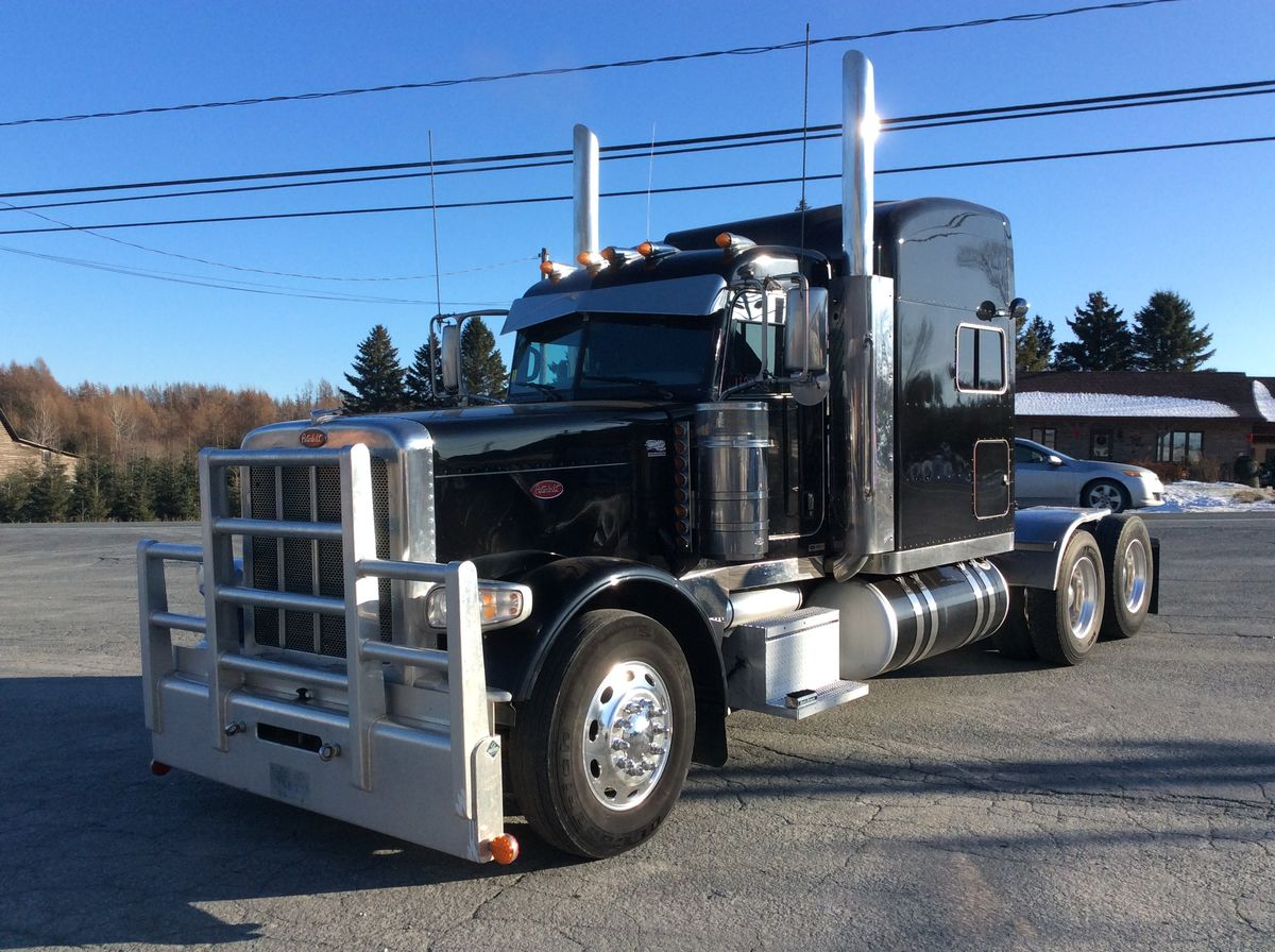 2016 PETERBILT 389 - Stock number: M2355 - Mileage: 900,000 km - Exterior color: Black - Engine: Cummins ISX 15 - Power: 550 hp - Torque: 1,850 - Brakes: Air - Axle spacing: 52 inches - Jacob engine brake: Yes - Traction: Full lock - Exhaust: Double - Transmission: 18 Speeds - Front axle: 13,200 lbs - Rear axles: 40,000 lbs - Differential: 40,000 lbs - Ratio: 3.91 - Suspension: Air - Cab: Mid-Roof - Wheels: Aluminum - Tires: 11R24.5 - Berth: Single - CA: 80 inches - Wheelbase: 245 inches - S.A.A.Q .: valid until NOVEMBER 2020 - Price on request only.  Note that we have two places where vehicles can be located, in Lévis or Saint-Georges. Please contact one of our advisers to be informed of the location of the vehicle before traveling.